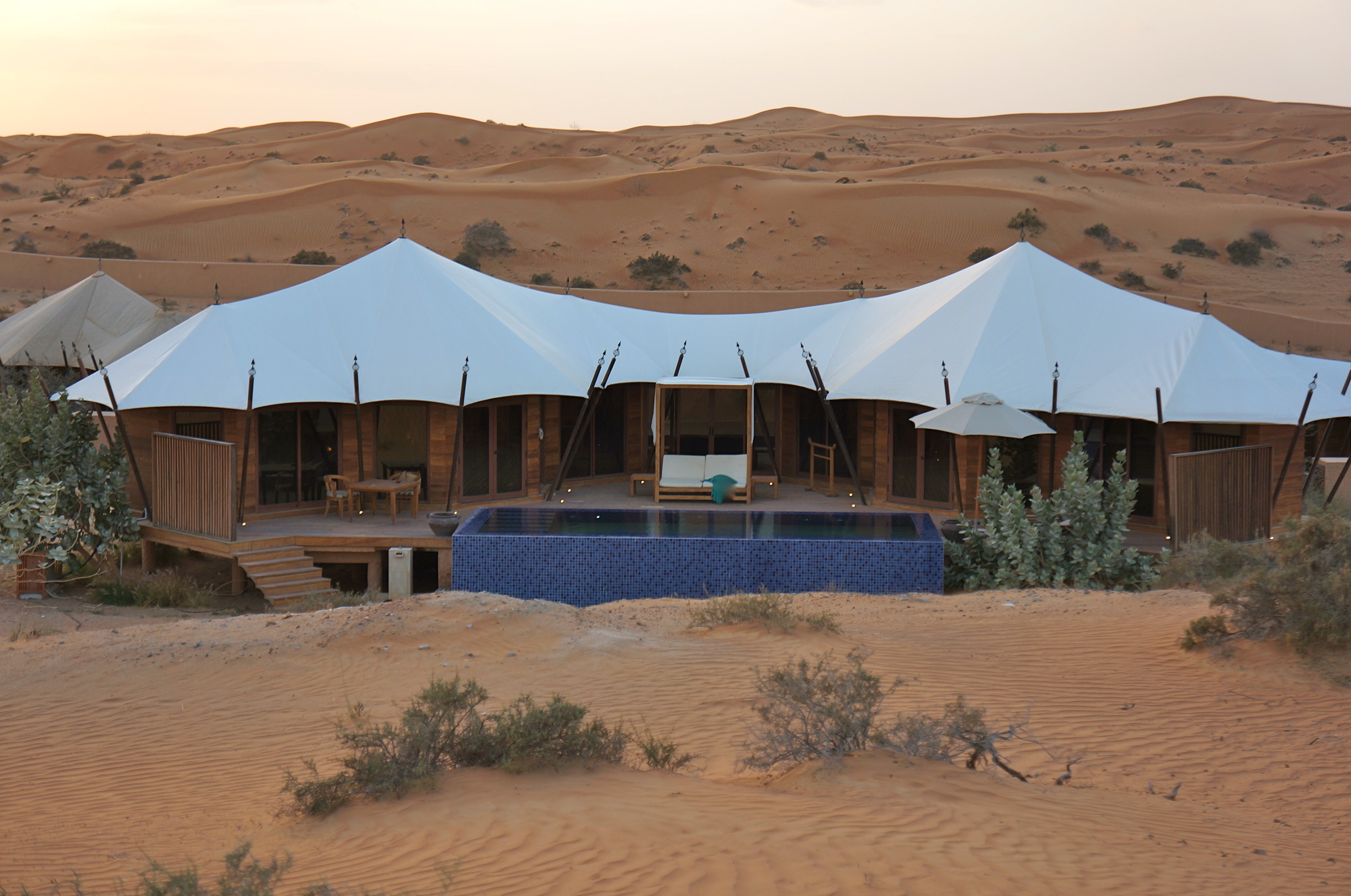 Our villa appears like a mirage against the vast desert backdrop.