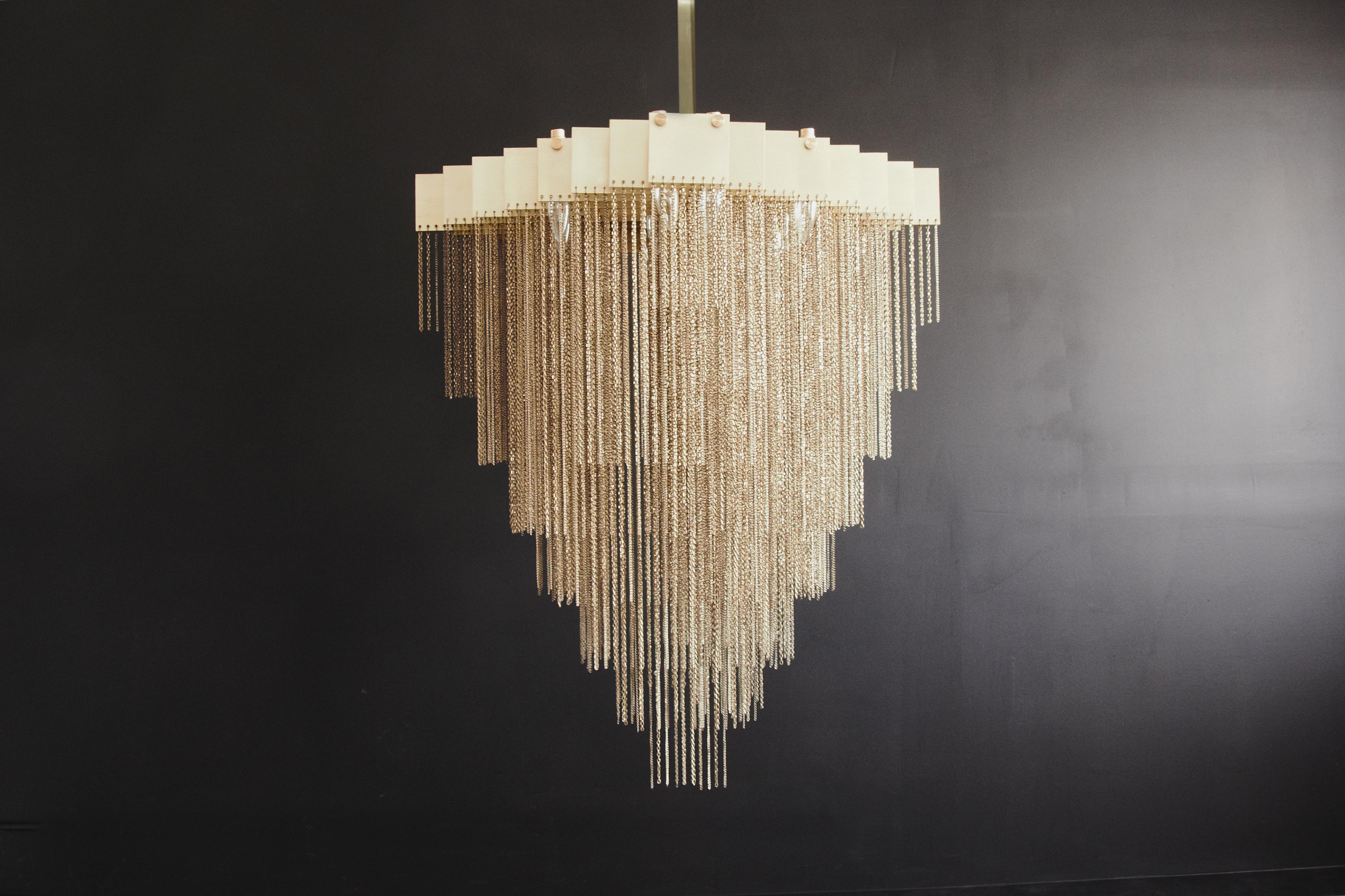 Suite ny owner kris fuchs picks the 12 best chandeliers for a brass chandelier designed by gabriel kakon and scott richler aloadofball Gallery