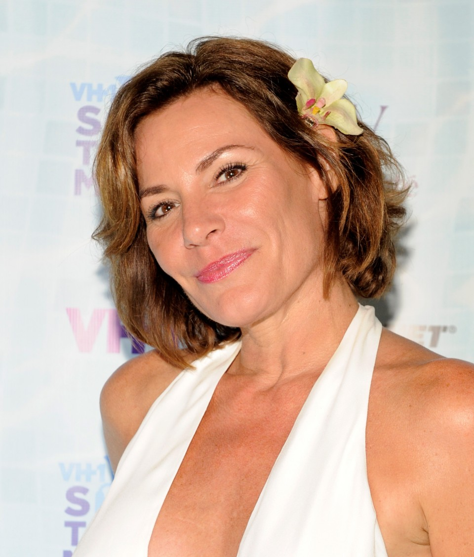"SAGAPONACK, NY - AUGUST 08:  LuAnn de Lesseps at VH1 Save The Music Foundation's ""Hamptons Live"" benefit hosted by Billy and Julie Macklowe at a private estate in Sagaponack, NY on August 8, 2015.  (Photo by Matthew Eisman/Getty Images for Vh1 Save The Music)"