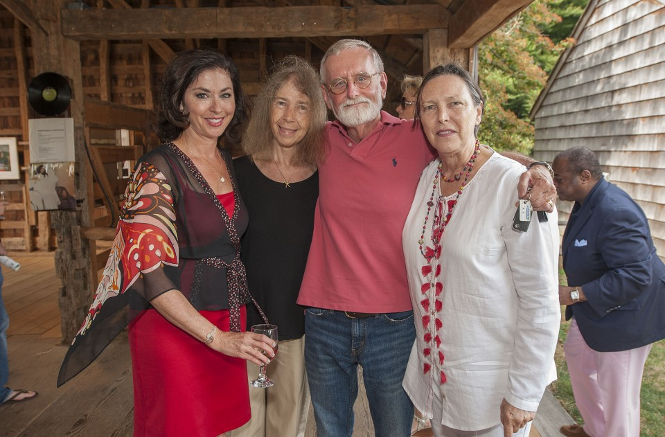 """The opening reception of """"Right On! - The Lennon Years,"""" an exhibition of photography by Susan Wood at the East Hampton Historical Society's Mulford Barn on Saturday, August 8th, 2015 Lynn Stefanelli, Roseanne and Richard Barons, Elana Prohaska Glinn"""