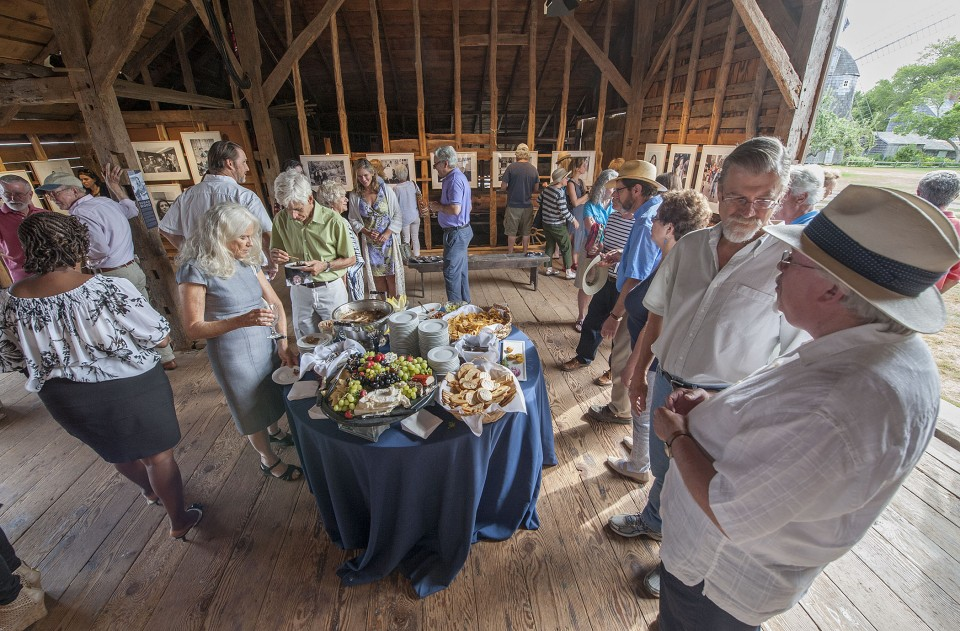"""The opening reception of """"Right On! - The Lennon Years,"""" an exhibition of photography by Susan Wood at the East Hampton Historical Society's Mulford Barn on Saturday, August 8th, 2015"""