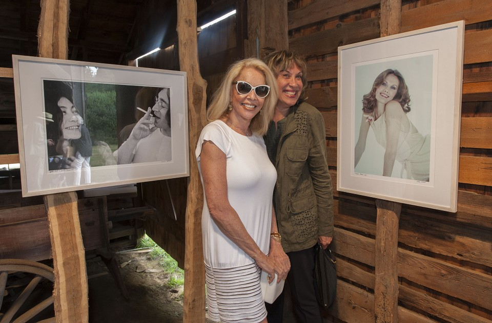 """The opening reception of """"Right On! - The Lennon Years,"""" an exhibition of photography by Susan Wood at the East Hampton Historical Society's Mulford Barn on Saturday, August 8th, 2015. Susan Silver and Judy Twersky"""