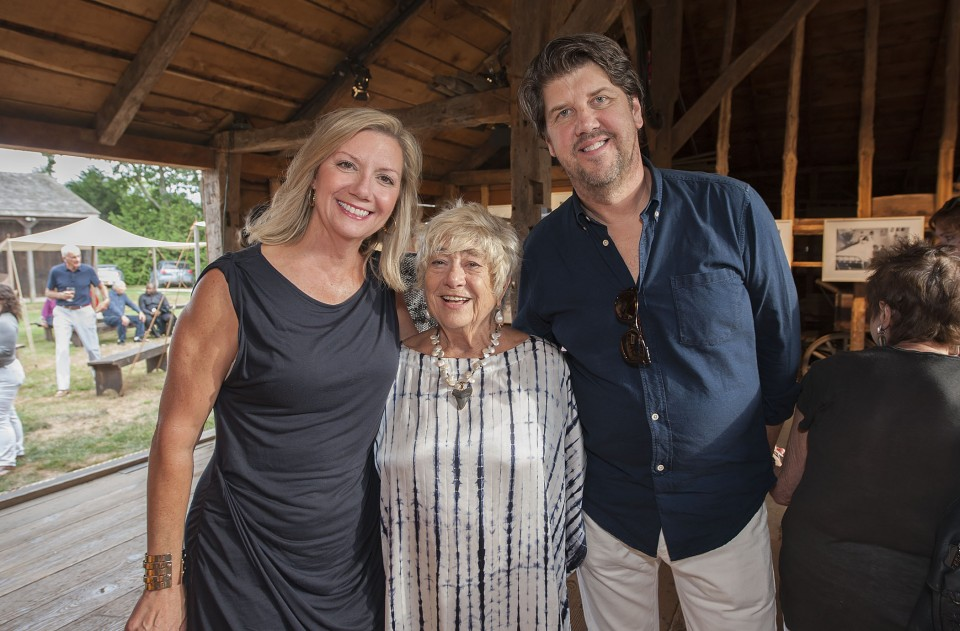 """The opening reception of """"Right On! - The Lennon Years,"""" an exhibition of photography by Susan Wood at the East Hampton Historical Society's Mulford Barn on Saturday, August 8th, 2015. Anne Chaisson, Susan Wood, Jeff Gillis"""
