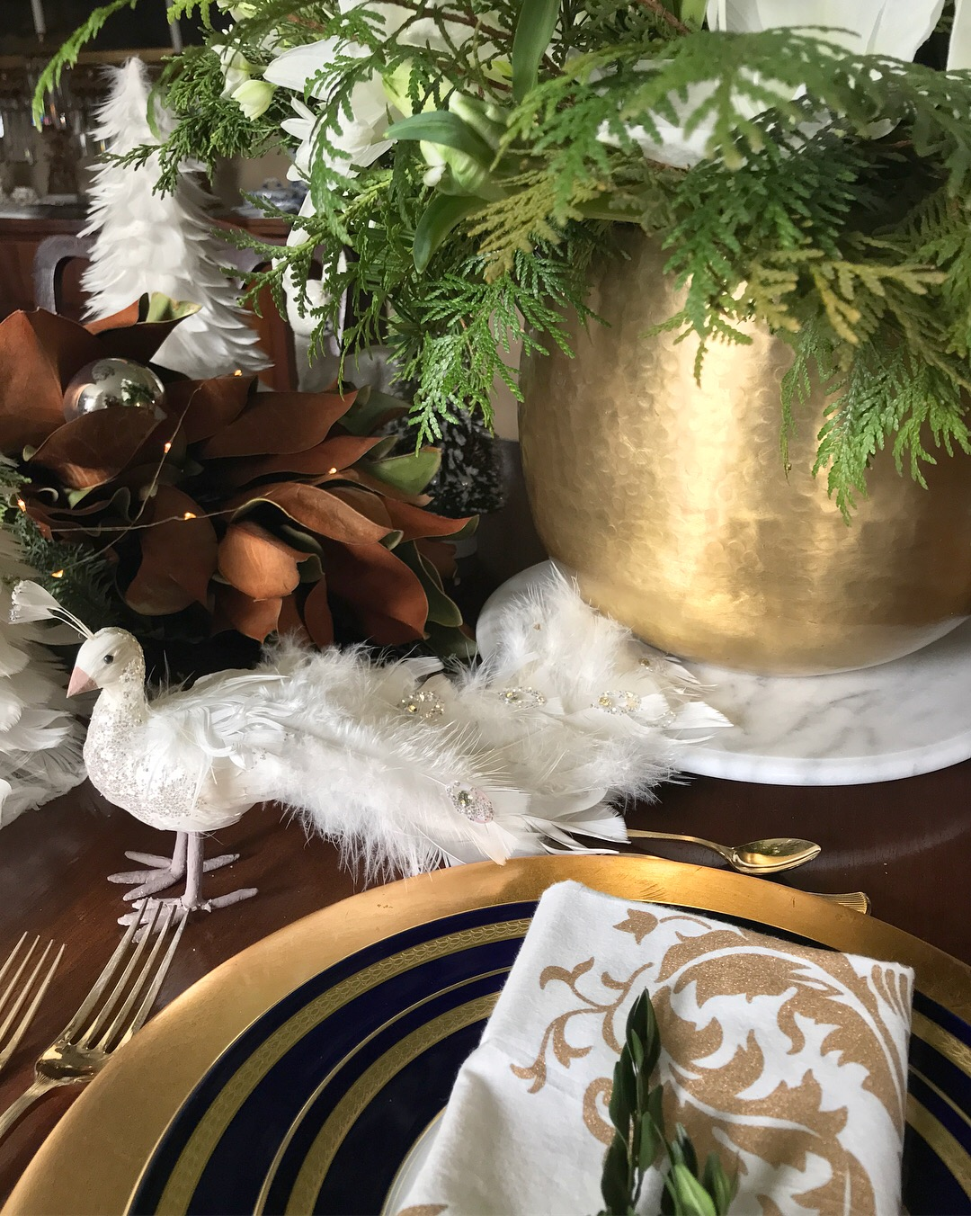 the white line and matte gold napkins were a find on a trip to abu dhabi the marble monogrammed lazy susan is by lilian